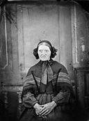 An old woman sitting and wearing a bonnet NLW3364968.jpg