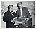 An unidentified man and Deputy Mayor Henry Scagnoli hold a ceremonial dish (12462114604).jpg
