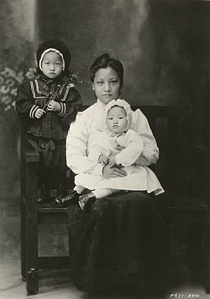 Anna May Wong - Anna May Wong seated in her mother's lap, c. 1905.