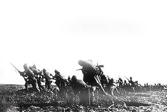 Third attack on Anzac Cove - Ottoman Turkish troops Going over the top in assault on British trench-line in Anzac Cove.