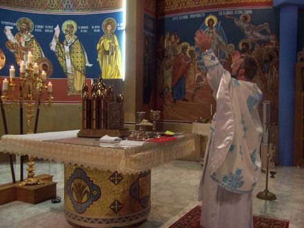 A contemporary Byzantine Catholic altar during the Divine Liturgy at St. Joseph Church in Chicago, Illinois. At altar.JPG