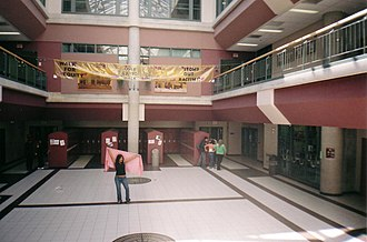 Newmarket High School - The atrium of the current N.H.S. Student groups often make banners that are attached to the railings of either hallways, as shown in the image.