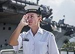 Australian sailor sounds a boatswain's pipe on board HMAS Success in July 2018.jpg