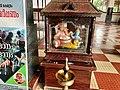 Baby Krishna on Ganapathy (Ganesha) lap in Malliyoor Maha Ganapathy Hindu temple Kerala India.jpg
