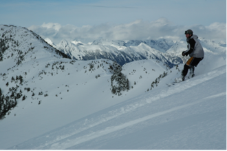 Backcountry snowboarding - A backcountry snowboarder.