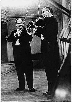 Rudolf Barshai and David Oistrakh performing Mozart's Sinfonia Concertante in Moscow Conservatory, c.1964 Barshai Oistrakh.jpg