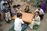 Children playing carrom in Yemen