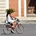 Biking Woman - Pisa (42765954762).jpg