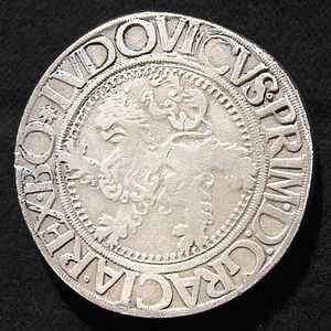 Dollar - 1525 Joachimsthaler of the Czech Kingdom was the first thaler (dollar). This is its reverse side, with the Bohemian Lion and the name of Ludovicus, the Czech king (Louis II)