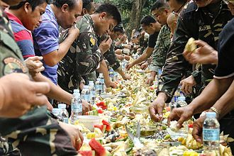 Boodle fight - Men of the 2nd Mechanized Infantry Brigade of the Philippine Army are joined by civilians in a boodle fight.