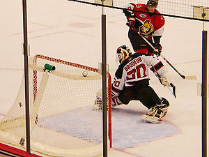 Puck slips Martin Brodeur for a goal.