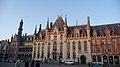 Brugges town square catches the last of the sun.jpg