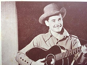 Buddy Williams (country musician) - Buddy Williams with his Black Gibson L 00 Guitar. This prized instrument was used on Buddy Williams recordings during the 1939 to 1945 period. Circa 1940.