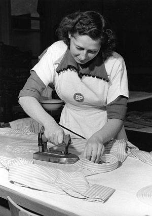 Ironing - Woman ironing a shirt (Köln, Germany 1953).