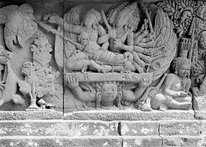Rama - Ravana kidnapping Sita while Jatayu on the left tried to help her. 9th century Prambanan bas-relief, Java, Indonesia