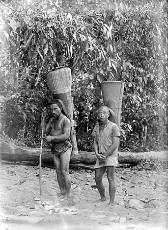 Alfur people - Forced Alfur workers by Japanese soldiers during World War 2 in Rabaul carrying the funnel-shaped baskets favored by Alfur people to collect enemy products.