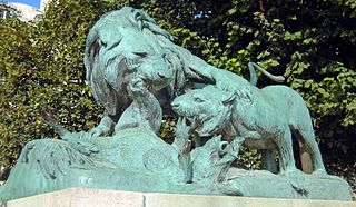 Lion and Lioness Fighting over a Boar