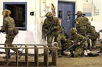 Reserve infantrymen train in urban operations circa 2004. Reserve training focuses on real world situations and the needs of the Regular Force who rely on the Reserves for augmentation on operational deployments.