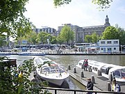 Tourist boats, also known as canal-bus, in Amsterdam, the Netherlands.