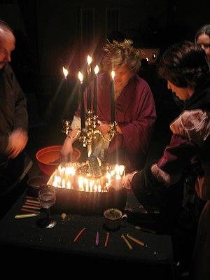 Wheel of the Year - Neopagans honoring the dead as part of a Samhain ritual