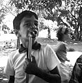 Caption- Louis is the kindergarten son of the caretaker who lives on the mission grounds. He's enjoying a hot dog at a school picnic. Brazil. 1964. (11313192224).jpg
