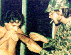 Carlos Lehder - Carlos Lehder (left) snorting cocaine with former prison mate Steven Yakovac on Norman's Cay (1976)