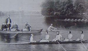 Francis Playford - Playford is standing in the boat on the left. His brother Henry Playford is stroking the eight in the foreground