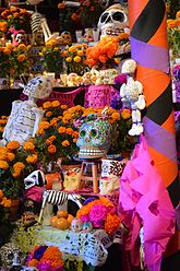 cempaschil alfeiques and papel picado used to decorate an altar
