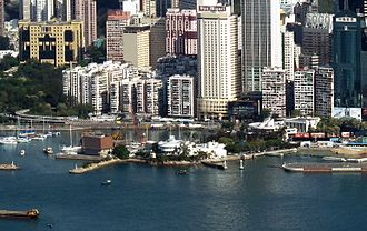 Kellett Island - Kellett Island with the Royal Hong Kong Yacht Club buildings in 2011. A portion of the Causeway Bay Typhoon Shelter is visible on the left of the picture.