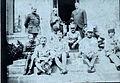 Cdt de Vial assis sur les marches du Q.G. 1915.jpg