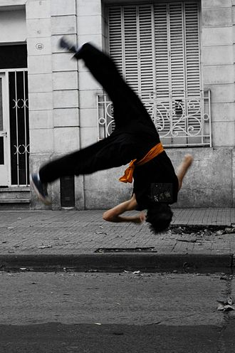 "Changquan - A man doing cekongfan (侧空翻; ""side somersault""), a common move in Changquan."