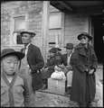 Centerville, California. Farm families of Japanese ancestry awaiting the evacuation buses which wil . . . - NARA - 537570.tif