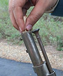 Charging cartridge down the barrel of a Mexican War era flintlock.jpg