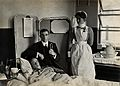 Charing Cross Hospital; Basil Hood with patient. Photograph, Wellcome V0029072.jpg