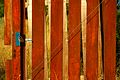 Chile - Puerto Varas 03 - brightly painted fence (6980444183).jpg