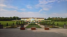 "Ludwigsburg Palace, again seen from the south garden. In the center of the image is a hedge cut to form the words ""Blühendes Barock"", meaning Blooming Baroque."