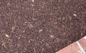 Mulch - Aged Compost mulch on a flower bed