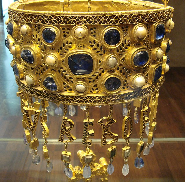 Detail of a suspended votive crown from Visigothic Spain, before 672 AD. Part of the Treasure of Guarrazar offered by Reccesuinth. Out of view are chains for suspension above, and a Byzantine pendant cross below. Alternate view. CoronaRecesvinto01.JPG