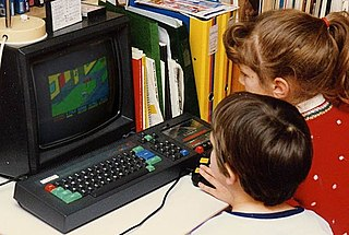 Children playing Paperboy on an Amstrad CPC 464 in the 1980s