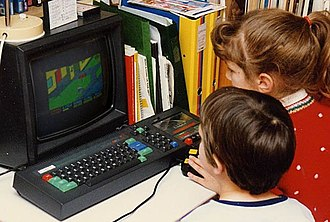 Home computer - Children playing Paperboy on an Amstrad CPC 464 in 1988