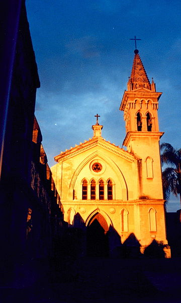 Cathedral's side-chapel at sunset Cuernavaca Catedral de madrugada.jpg
