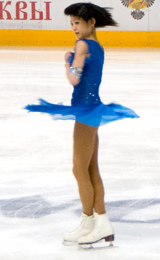 Angular momentum - A figure skater conserves angular momentum – her rotational speed increases as her moment of inertia decreases by drawing in her arms and legs.