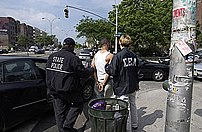 American drug law enforcement agents detain a man in 2005.
