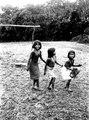Dansande småflickor. Den första slår med handen på en liten trumma. Rio Jaque, v - SMVK - 004068.tif