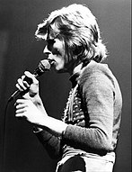A photograph of David Bowie performing at the ABC music program In Concert, in October 1974.