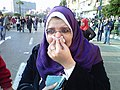 Day of Anger woman reacting to teargas.jpg
