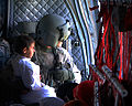 Defense.gov News Photo 100811-A-8481S-127 - U.S. Army Sgt. Kristopher Perkins right a CH-47 Chinook helicopter crew chief with Bravo Company Task Force Raptor 3rd Combat Aviation Brigade.jpg