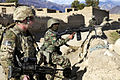 Defense.gov News Photo 110121-A-1182G-037 - U.S. Army Spc. Mason Lembke and Afghan soldiers provide security during a patrol through Mangow village in Afghanistan s Laghman province on Jan.jpg