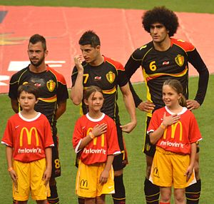 Steven Defour - Defour (left) with Belgian teammates Kevin Mirallas (middle) and Marouane Fellaini before a friendly against the United States on 29 May 2013