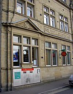 Detail of the Post Office, Park Street, Brighouse 'Letter Box' is carved in stone, and the emblem of mercury is in the pediment above. The VR monogram is in the centre of the carved banner, between 'Post' and 'Office'. The post office has since been moved to a shop unit off Market Street.